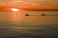Kayaking at Sunset. Two Kayakers Enjoy a Sunset on Lake Ontario Stock Photo
