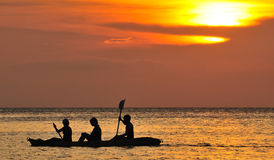 Kayaking at sunset Royalty Free Stock Image