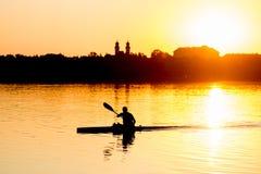 Kayaking at sunset Royalty Free Stock Photos