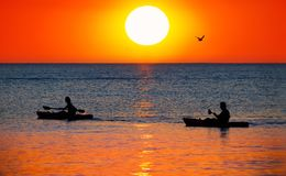Kayaking during sunset. Two people enjoying the sunset while in Cancun Mexico Royalty Free Stock Photo