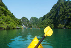 Kayaking though the Halong bay first person. View royalty free stock photos