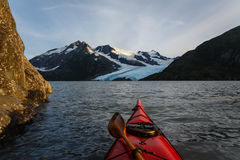 Kayaking to glacier in Alaska wilderness on sunny summer day Royalty Free Stock Photos