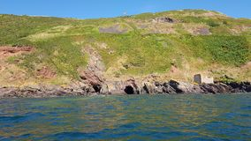Kayaking in to plymouth old smugglers  caves. devon uk Stock Photos