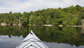 Kayaking on a Tranquil Lake Royalty Free Stock Photo