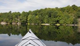 Kayaking on a Tranquil Lake Royalty Free Stock Photo