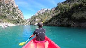 Kayaking in Verdon Canyon in springtime, Provence. France. Man eploring Verdon Canyon in kayak. Provence. France stock footage