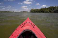 Kayaking View. A view from a red kayak on a lake Stock Photo