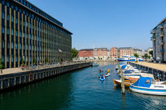 Kayaking in a water canal in Copenhagen royalty free stock image