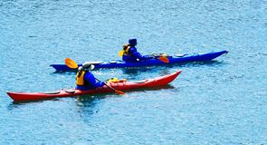 Kayaking weekend. Two female kayakers out for an active weekend Royalty Free Stock Photo