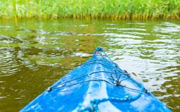 Kayaking by wild river in poland (Omulew river). Kayaking by wild river in forest in poland (Omulew river near Nidzica). Summer recreation stock photo