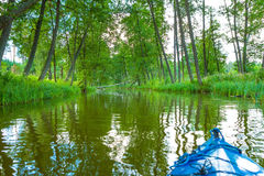 Kayaking by wild river in poland (Omulew river). Kayaking by wild river in forest in poland (Omulew river near Nidzica). Summer recreation Stock Photos