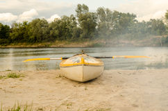 Kayaking on yellow boat near the river Stock Photos