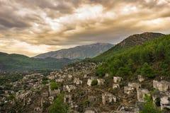 Kayakoyhuizen in historcial Lycian-dorp van Kayakoy, Fethiye, Mugla, Turkije Spookstad Kayaköy, als Lebessos in vroeger tijden w royalty-vrije stock foto's