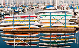 Kayaks. Two stacks of colorful kayaks ready for rent on a pier at the marina in Everett, Washington, north of Seattle.  Horizontal Royalty Free Stock Images
