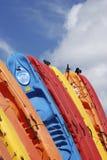 Kayaks. A dozen of kayaks tighten together with a background of a blue sky on Kauai island, Hawaii Stock Photos