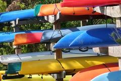 Kayaks. Rack of colorful kayaks stock image