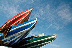 Kayaks against the blue sky Royalty Free Stock Photo