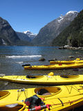 Kayaks against mountain backdrop Royalty Free Stock Images