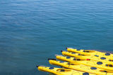 Kayaks in Bar Harbor. Row of kayaks in the water in Bar Harbor, Maine Stock Photography