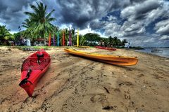 Kayaks on a beach. Two colorful kayaks on a sandy beach; photo taken somewhere in Singapore Stock Photo