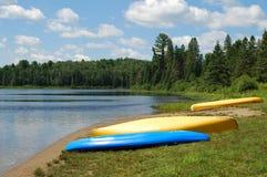 Kayaks on a beach. Three kayaks on a beach, Algonquin Provincial Park, Ontario, Canada Stock Photos