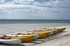 Kayaks on beach. Kayaks lined up on beautiful tropical beach Stock Photography