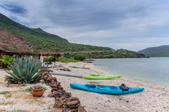Kayaks on a Beach in Baja California Sur, Mexico Royalty Free Stock Photos