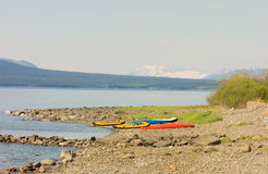 Kayaks on the beach at beautiful lake atlin in the springtime Stock Images