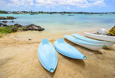 Seascape in Grand Baie, Mauritius. Kayaks on the beach in Grand Baie, Mauritius. Mauritius is a major tourist destination, ranking 3rd in the region and 56th Royalty Free Stock Images