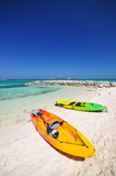 Kayaks and the beautiful  beach Royalty Free Stock Image