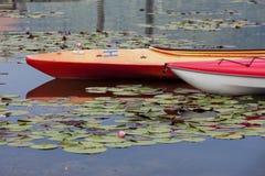 Kayaks on calm water. Royalty Free Stock Image