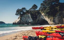 Kayaks on Cathedral Cove beach, Coromandel. New Zealand Stock Photography