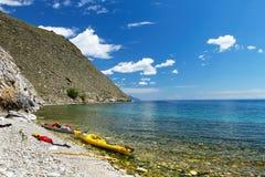Kayaks on the coast of Lake Baikal Royalty Free Stock Image
