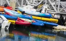 Kayaks. Colorful kayaks stacked on the pier Stock Photography