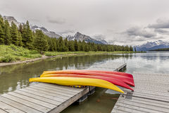 Kayaks on a Dock - Maligne Lake, Canada. Kayaks on a Dock at Maligne Lake - Jasper National Park, Alberta, Canada Stock Photos