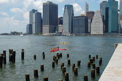 Kayaks in the East River, New York City. Colorful kayaks in the East River with lower Manhattan in the background Stock Photo