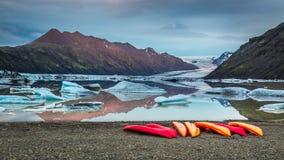 Kayaks at glacial lake in the mountains, Iceland Stock Photos
