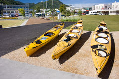 Kayaks for hire on a city waterfront Royalty Free Stock Photo