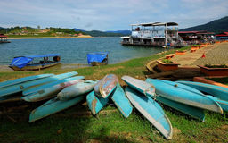 Kayaks and Houseboats Stock Images