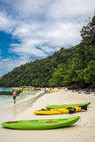 Kayaks in Koh Phi Phi. A few kayaks laying on the beach in monkey island - thailand Royalty Free Stock Images