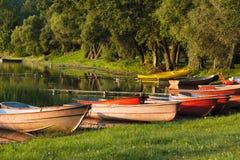 Kayaks on the lake bank Royalty Free Stock Photography