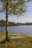 Kayaks at lake shore kirchsee stock photos