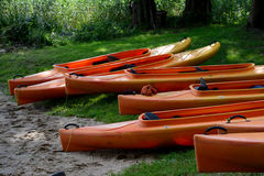 Kayaks on lake shore Royalty Free Stock Photography
