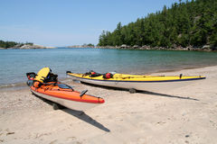 Kayaks in Lake Superior Provincial Park. Two sea kayaks on the beach at Sinclair Cove. Lake Superior Provincial Park, Ontario Royalty Free Stock Photos