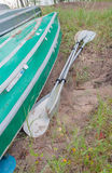 Kayaks lay upside down with oars. Inverted paddles and kayaks lay Stock Photo
