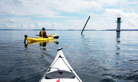 Kayaks and lighthouse. White and yellow kayak by lighthouse royalty free stock images