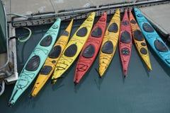 Kayaks lined up at a marina. Royalty Free Stock Images
