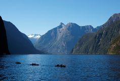 Kayaks on Milford Sound stock photography
