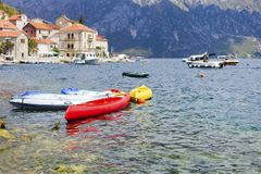 Kayaks moored at the shore. Of the Adriatic sea Stock Photos