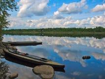 Kayaks on the mooring at the river bank Royalty Free Stock Photo